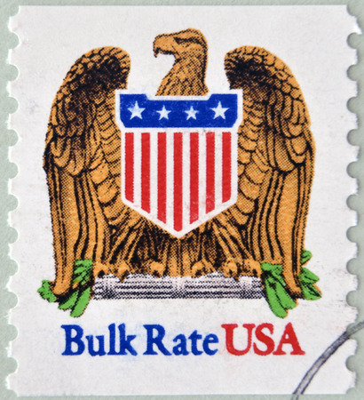 UNITED STATES OF AMERICA - CIRCA 1991: A stamp printed in USA shows eagle and shield, bulk rate, circa 1991  photo