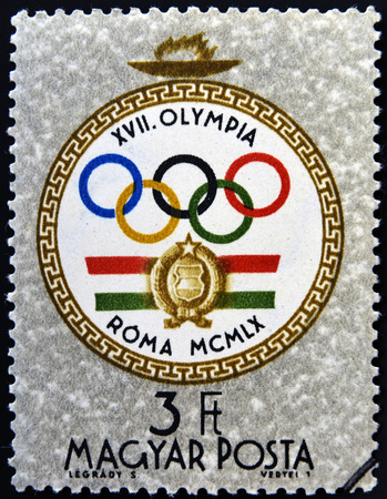 olympic symbol: HUNGARY - CIRCA 1960: A stamp printed in Hungary shows emblem, devoted to the Olympic games in Rome, circa 1960