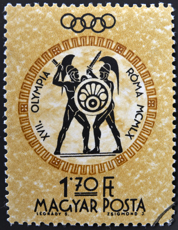 HUNGARY - CIRCA 1960: A stamp printed in Hungary shows gladiators, devoted to the Olympic games in Rome, circa 1960