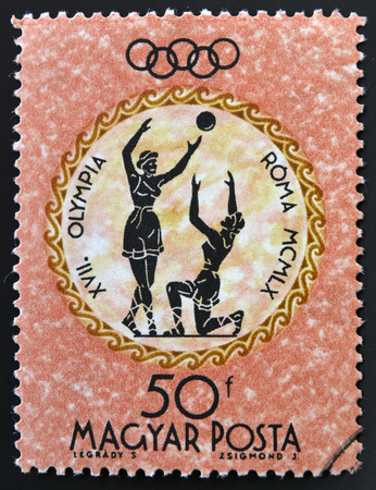 HUNGARY - CIRCA 1960: A stamp printed in Hungary shows womens volleyball, devoted to the Olympic games in Rome, circa 1960