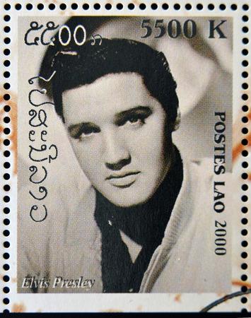 elvis: LAOS - CIRCA 2000: A stamp printed in Laos showing Elvis Presley, circa 2000