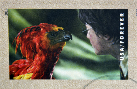 fawkes: UNITED STATES OF AMERICA - CIRCA 2013: A stamp printed in USA dedicated to Harry Potter shows Harry Potter and Fawkes the Phoenix, circa 2013 Editorial