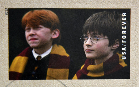 ron: UNITED STATES OF AMERICA - CIRCA 2013: A stamp printed in USA dedicated to Harry Potter shows Harry Potter and Ron Weasley, circa 2013