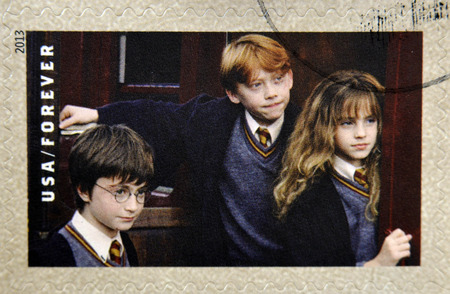 ron: UNITED STATES OF AMERICA - CIRCA 2013: A stamp printed in USA dedicated to Harry Potter shows Harry Potter, Ron Weasley, and Hermione Granger, circa 2013