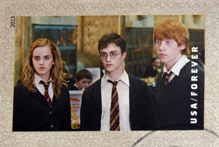 ron: UNITED STATES OF AMERICA - CIRCA 2013: A stamp printed in USA dedicated to Harry Potter shows Hermione Granger, Harry Potter, and Ron Weasley, circa 2013