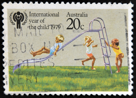 AUSTRALIA - CIRCA 1979: A stamp printed in Australia dedicated to the International Year of the Child shows Children playing on Slide, circa 1979.