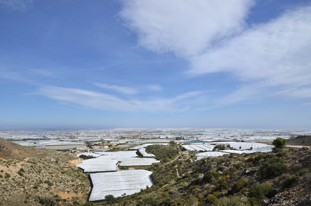 The sea of plastic in Almeria, also known for the great number of greenhouses  Фото со стока