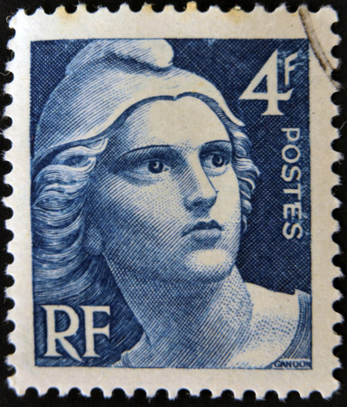 FRANCE - CIRCA 1945: A stamp printed in France shows Marianne, circa 1945.