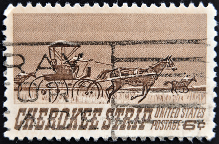 cherokee: UNITED STATES OF AMERICA - CIRCA 1968: a stamp printed in USA shows Homesteaders Racing to Cherokee Strip, 75th Anniversary of the Opening of the Cherokee Strip, circa 1968