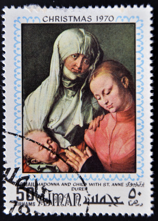 durer: AJMAN - CIRCA 1970: Stamp printed in Ajman shows Madonna and child with St. Anna by Durer, circa 1970