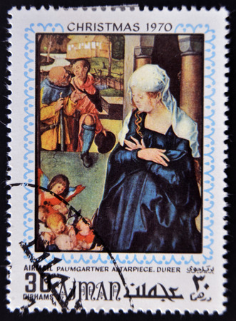 durer: AJMAN - CIRCA 1970: Stamp printed in Ajman shows Paumgartner altarpiece by Durer, circa 1970