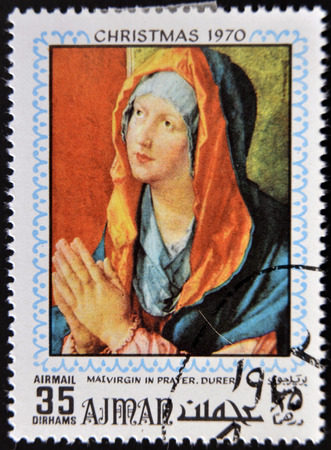 durer: AJMAN - CIRCA 1970: Stamp printed in Ajman shows Virgin in prayer by Durer, circa 1970 Stock Photo