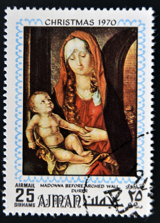durer: AJMAN - CIRCA 1970: Stamp printed in Ajman shows Madonna before arched wall by Durer, circa 1970