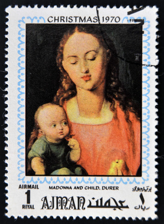 durer: AJMAN - CIRCA 1970: Stamp printed in Ajman shows Madonna and child by Durer, circa 1970