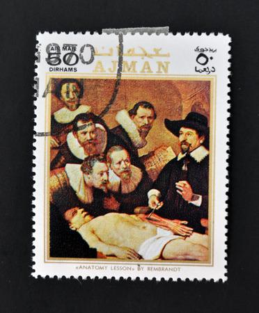 AJMAN - CIRCA 1970: A stamp printed in Ajman shows Anatomy lesson by Rembrandt, circa 1970  Stock Photo