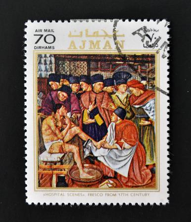 AJMAN - CIRCA 1970: A stamp printed in Ajman shows Hospital scenes, fresco from 17th century, circa 1970
