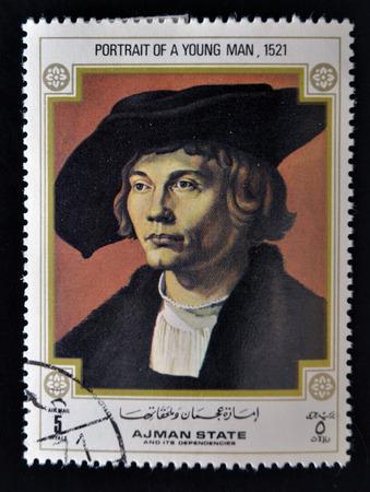 printmaker: AJMAN - CIRCA 1970: A stamp printed in Ajman shows Portrait of Young Man, by Albrecht Durer (1471-1528), circa 1970