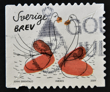 SWEDEN - CIRCA 2009: stamp printed in Sweden shows Swans and hearts, circa 2009  photo
