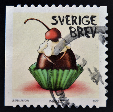 SWEDEN - CIRCA 2007: stamp printed in Sweden shows Chocolate bonbon with whipped cream and cherry, circa 2007 photo