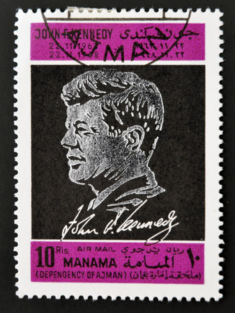 AJMAN - CIRCA 1970: A stamp printed in Ajman shows John F. Kennedy, circa 1970