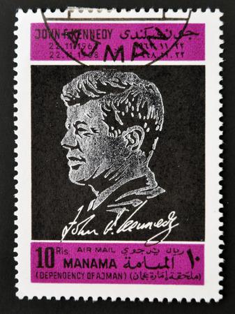 john fitzgerald kennedy: AJMAN - CIRCA 1970: A stamp printed in Ajman shows John F. Kennedy, circa 1970