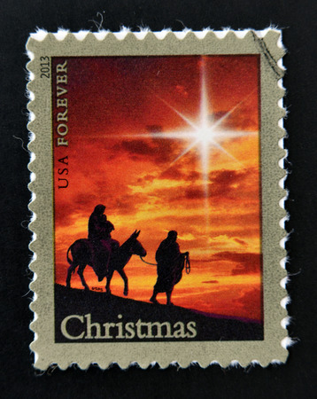 postmarked: UNITED STATES OF AMERICA - CIRCA 2013: a stamp printed in usa shows image of Joseph Childrens and Mary Arriving in Bethlehem, circa 1981