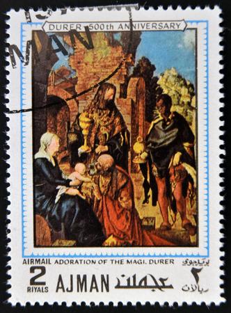 durer: AJMAN - CIRCA 1970: un francobollo stampato in Ajman mostra Adorazione dei Magi, dipinto da Albrecht Durer, circa 1970