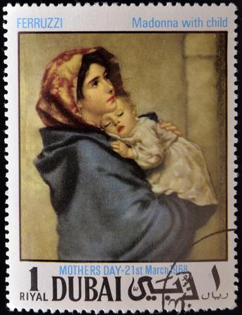 DUBAI - CIRCA 1968: A stamp printed in Dubai shows painting of Roberto Ferruzzi - Madonna with child, circa 1968  Editorial