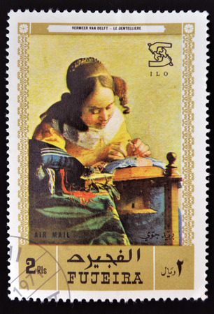 YEMEN - CIRCA 1971: A stamp printed in Fujeira shows The Milkmaid by Johannes Vermeer, circa 1968  Editorial