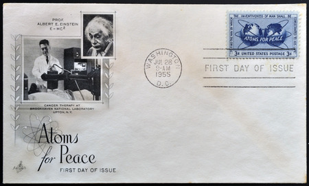 encircling: UNITED STATES OF AMERICA - CIRCA 1955: a stamp printed in USA shows Atomic Energy Encircling the Hemispheres, Atoms for Peace, circa 1955  Editorial