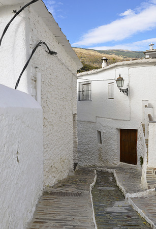 A street in Pampaneira a white village in the Alpujarras, Andalusia photo