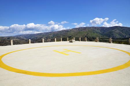 heliport: Helipad in mountain