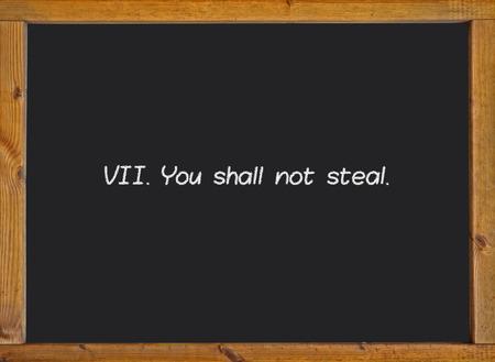 commandment: The seventh commandment of christian catholic on a blackboard Stock Photo