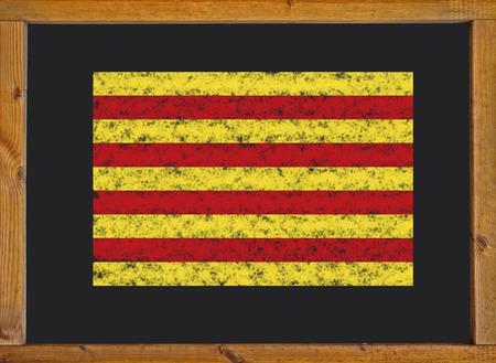 The flag of the autonomous community of Catalonia on a blackboard photo