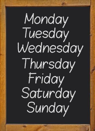 the weekdays written on a blackboard photo