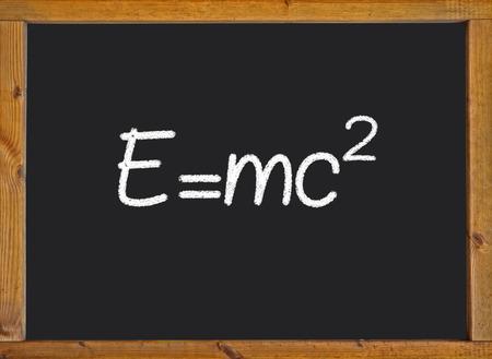 Theory of relativity (E=mc2) written on a chalkboard photo