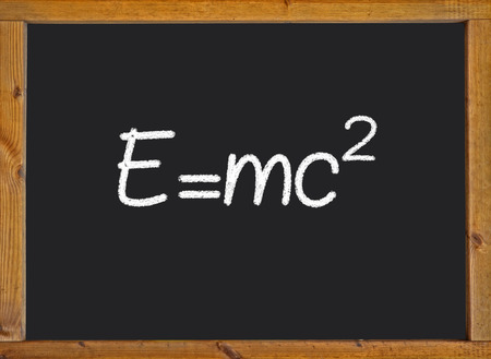 the theory of relativity: Theory of relativity (E=mc2) written on a chalkboard
