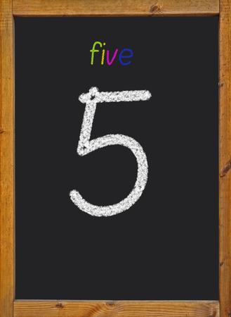 5 written on a black blackboard photo
