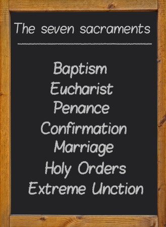 sacraments: The seven sacraments written on a blackboard Stock Photo