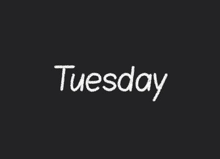 Tuesday written on a blackboard photo