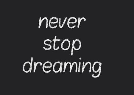 never stop dreaming written on a blackboard photo
