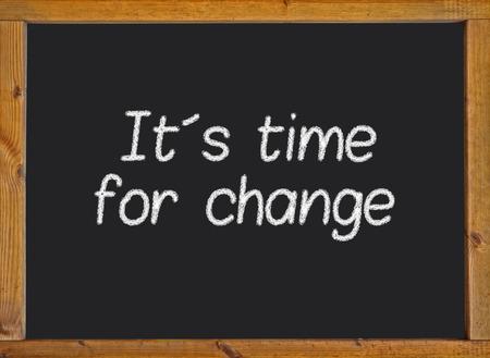 It´s time for change written on a blackboard photo