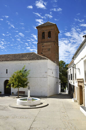 alpujarra: Narila Square with church and fountain