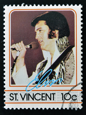 songster: ST. VINCENT - CIRCA 1985: A stamp printed in St. Vincent, shows Elvis Presley, circa 1985. Editorial