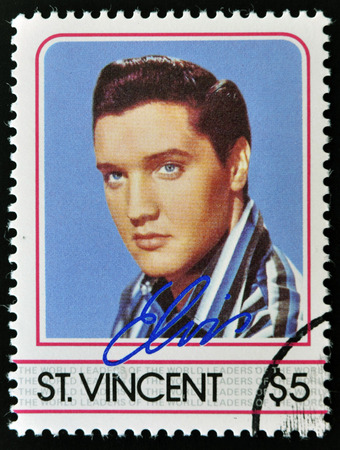 elvis presley: ST. VINCENT - CIRCA 1985: A stamp printed in St. Vincent, shows Elvis Presley, circa 1985. Editorial