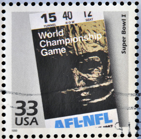 super bowl: UNITED STATES OF AMERICA - CIRCA 1999: Stamp printed in USA dedicated to celebrate the century 1960s, shows super bowl I, circa 1999 Editorial