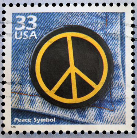 anti war: UNITED STATES OF AMERICA - CIRCA 1999: Stamp printed in USA dedicated to celebrate the century 1960s, shows peace symbol, circa 1999