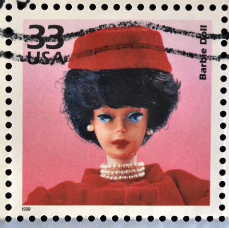 barbie: UNITED STATES OF AMERICA - CIRCA 1999: Stamp printed in USA dedicated to celebrate the century 1960s, shows barbie doll, circa 1999 Editorial