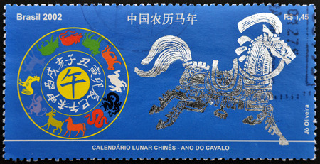 chinese postage stamp: BRAZIL - CIRCA 2002: A stamp printed in Brazil shows Chinese Lunar Calendar - Year of the Horse, circa 2002 Stock Photo
