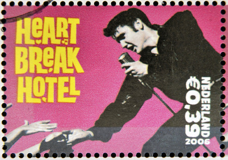 elvis: HOLLAND - CIRCA 2006 A stamp printed in Holland shows Elvis Presley, Heart break Heart, circa 2006 Stock Photo